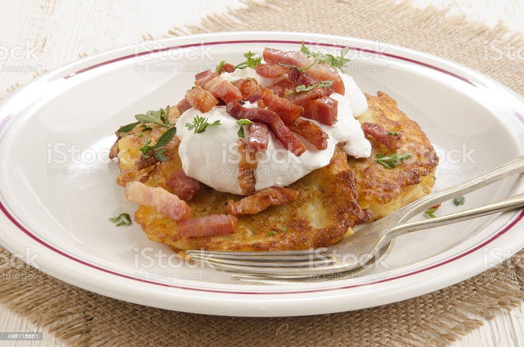 boxty, irish pancake with sour cream stock photo