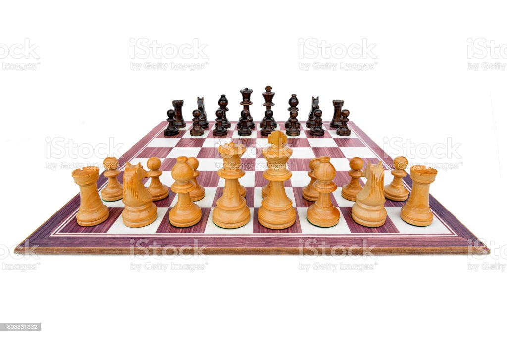 boxwood chessboard with all pieces on white background stock photo