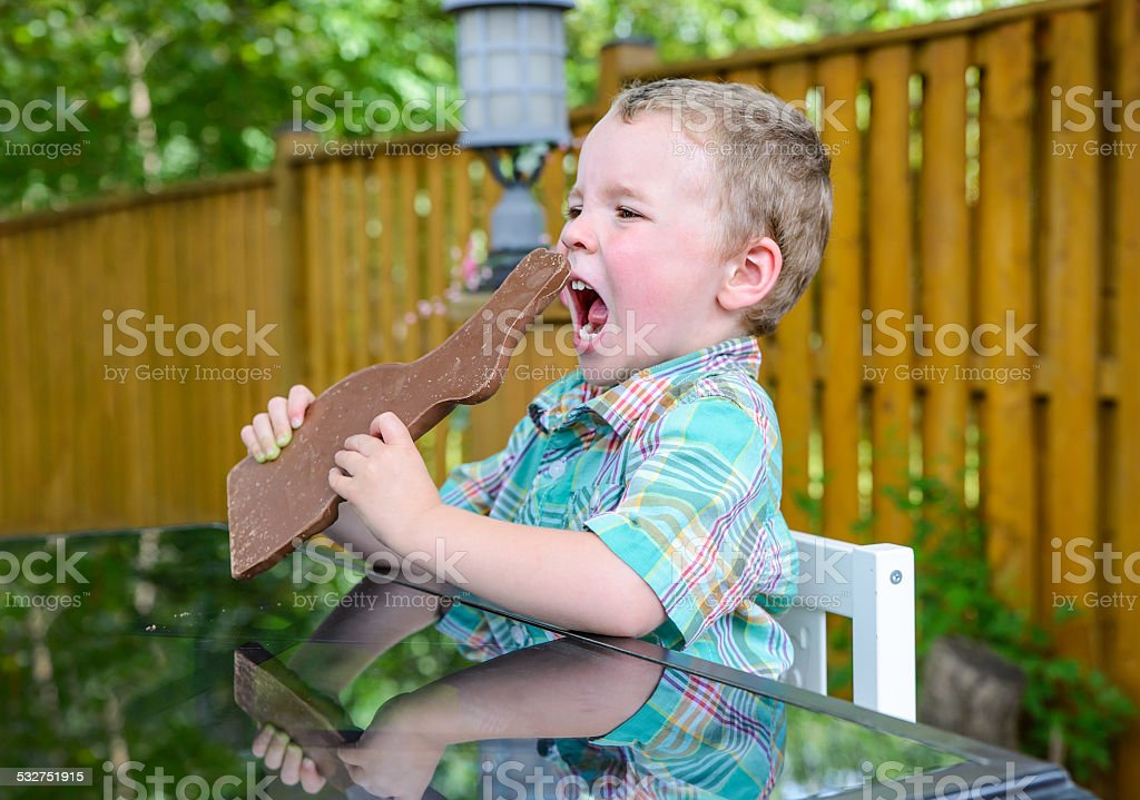 Boy About to Eat a Chocolate Bunny stock photo