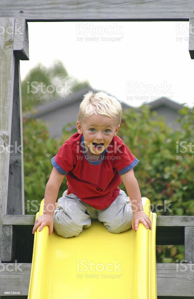 Boy About to go Down Slide royalty-free stock photo