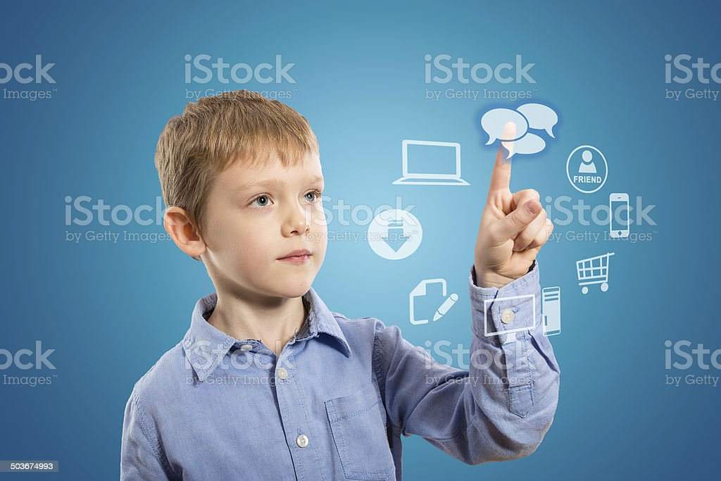 Boy accessing futuristic entertainment applications stock photo