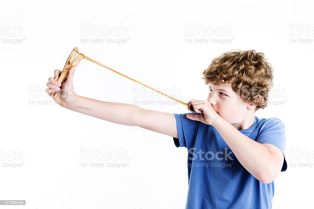Boy Aiming a Catapult Against a White Background stock photo