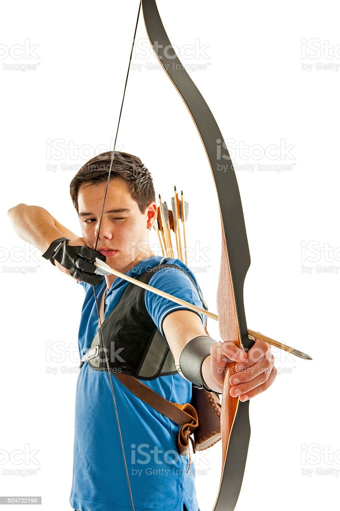 Boy aiming with bow an arrow stock photo