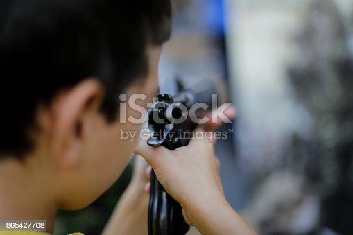 A boy handles a 9 mm pistol