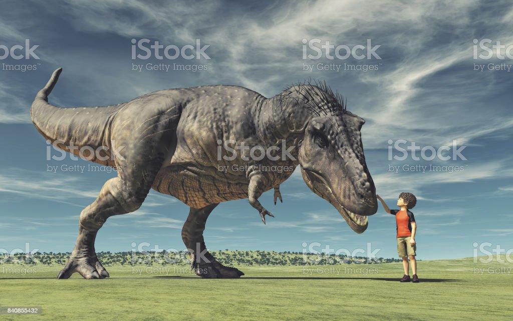 A boy and a big dinosaur stock photo