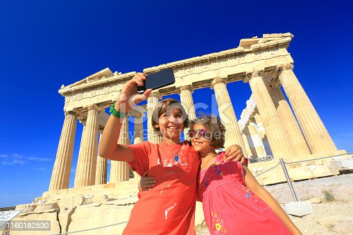 istock A boy and a girl taking a selfie in front of the Parthenon/Athens, in Greece 1160182530