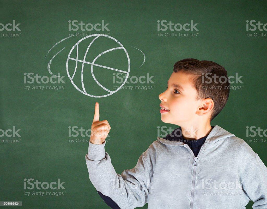 Boy and basketball stock photo