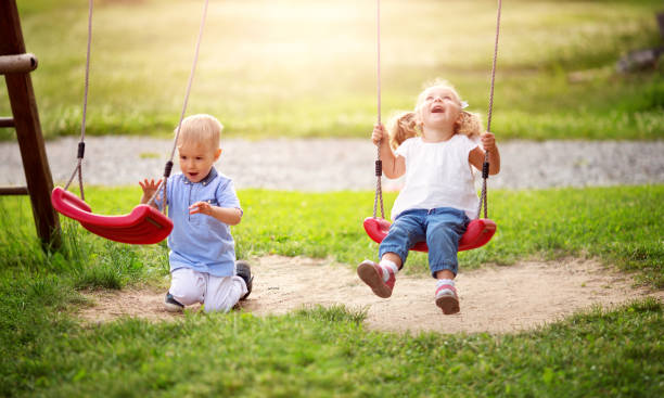 Boy and boy playing on the backyard stock photo