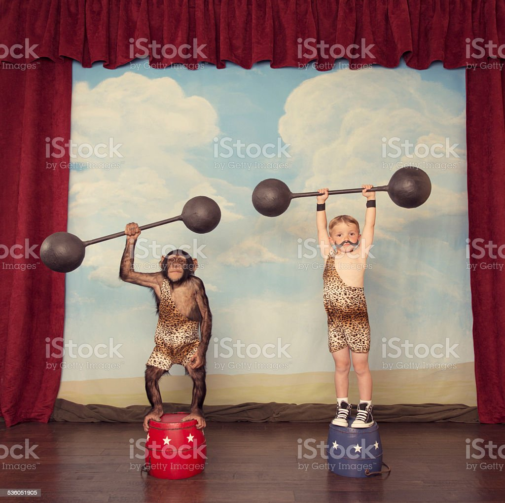 Boy and Chimp Friend in the Circus stock photo