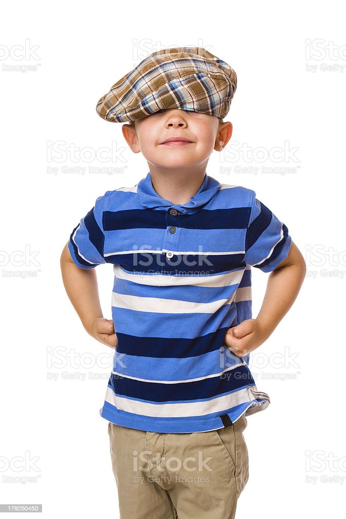 Boy and cloth cap royalty-free stock photo