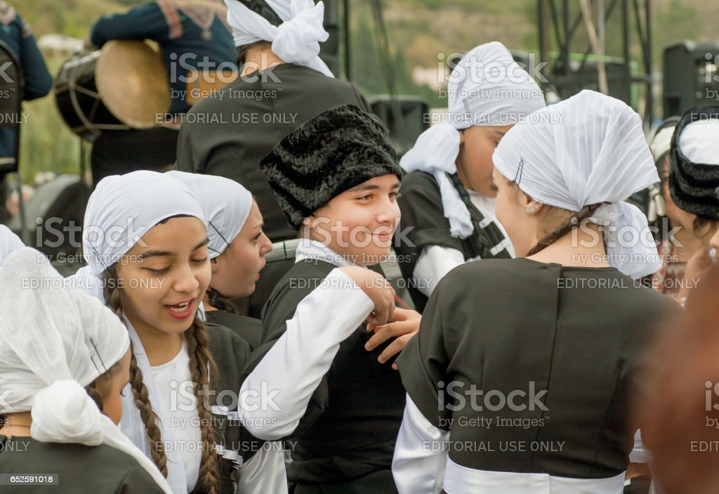 Unidentified boy and cute girls in traditional Georgian costumes...