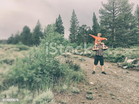 997711042istockphoto Boy and dad adventure together in the wilderness 514930576
