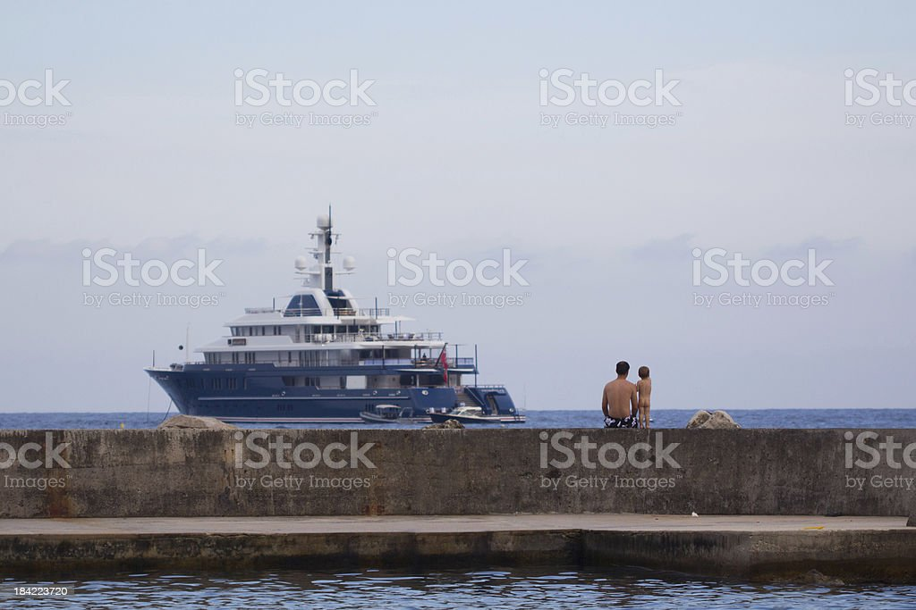 Boy and daddy  watching ship royalty-free stock photo