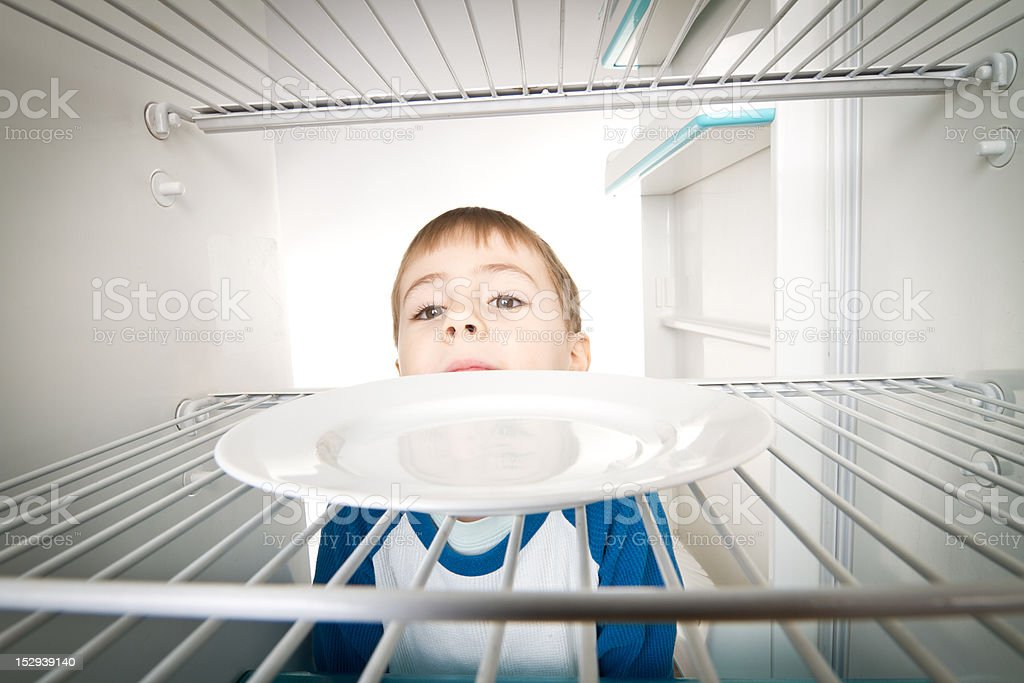 Boy and Empty Refrigerator stock photo
