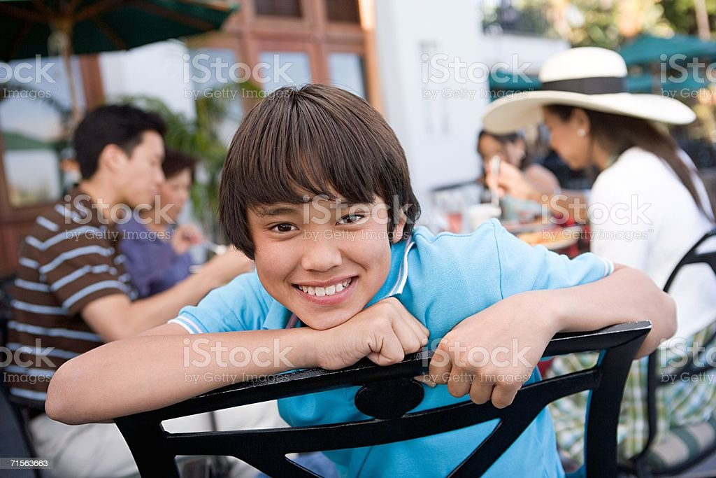 Boy and family at restaurant stock photo