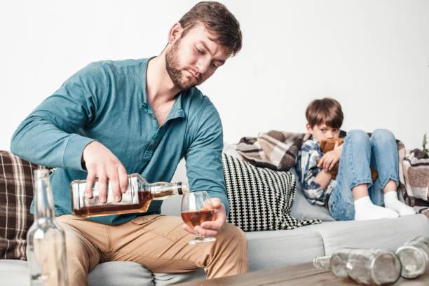Boy and father alcoholic social problems concept man pouring whiskey picture id1149933529?b=1&k=6&m=1149933529&s=612x612&w=0&h= 8o sorxq3m 5gkqsrjeotb1mzc3r3iihi97fkkkiv0=