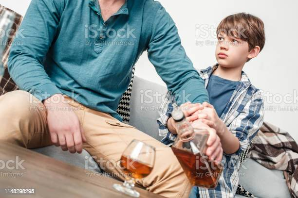 Boy and father alcoholic social problems concept stop drinking picture id1148298295?b=1&k=6&m=1148298295&s=612x612&h=q0x3ncfcctsfkzxffrp83j97huq34t7x73xstrokphe=