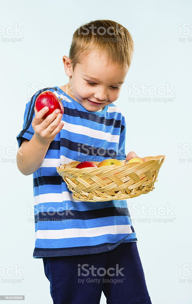 Boy and fruit basket royalty-free stock photo
