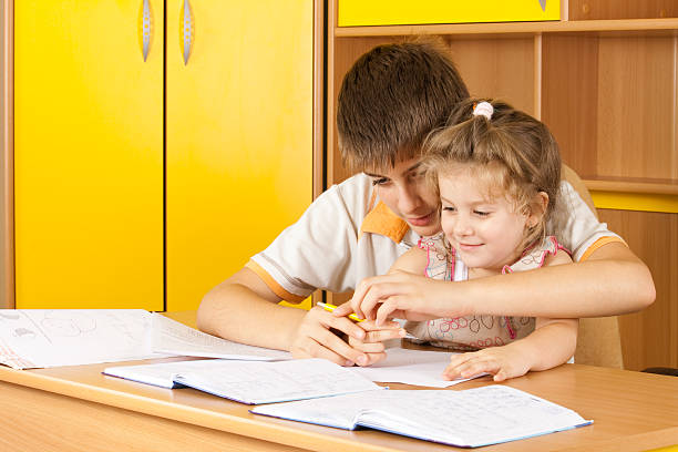 Boy and girl are doing homework stock photo