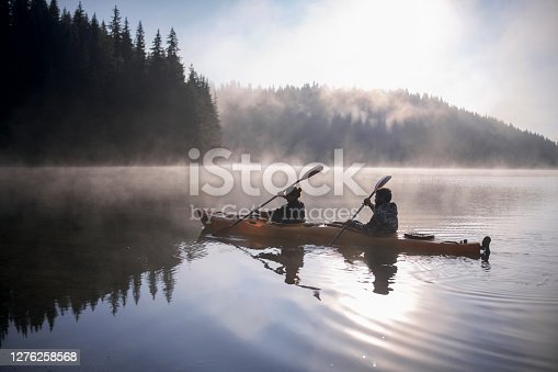 Couple is travelling with kayak boat at the mountains