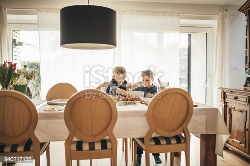 istock boy and girl baking cookies on the kitchen desk while having a lot of fun 940217132