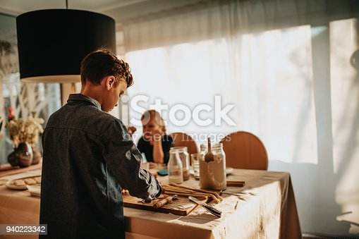 664420980 istock photo boy and girl baking cookies on the kitchen desk while having a lot of fun 940223342
