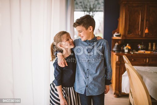 istock boy and girl baking cookies on the kitchen desk while having a lot of fun 940236144