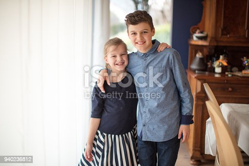 istock boy and girl baking cookies on the kitchen desk while having a lot of fun 940236812