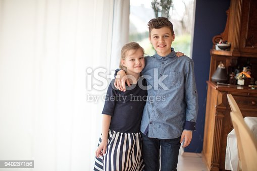 istock boy and girl baking cookies on the kitchen desk while having a lot of fun 940237156