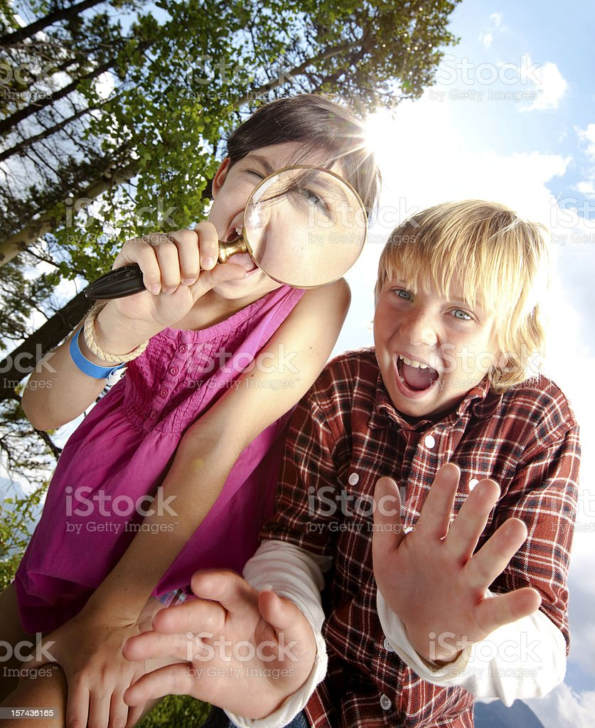 Boy and girl being curious. stock photo