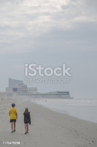 585604690 istock photo Boy and girl during Cloudy day at Atlantic city beach 1170475238