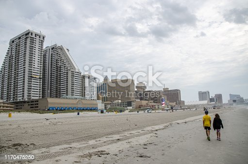 585604690 istock photo Boy and girl during Cloudy day at Atlantic city beach 1170475250