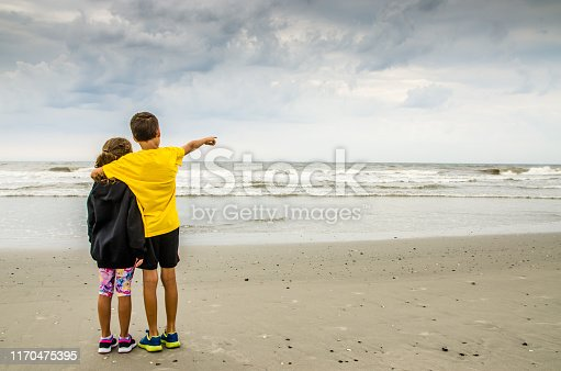 585604690 istock photo Boy and girl during Cloudy day at Atlantic city beach 1170475395