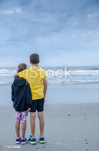 585604690 istock photo Boy and girl during Cloudy day at Atlantic city beach 1170475559