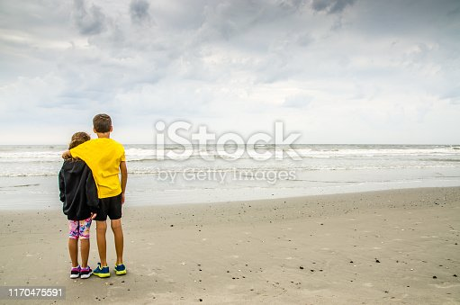 585604690 istock photo Boy and girl during Cloudy day at Atlantic city beach 1170475591