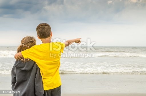 585604690 istock photo Boy and girl during Cloudy day at Atlantic city beach 1170475629