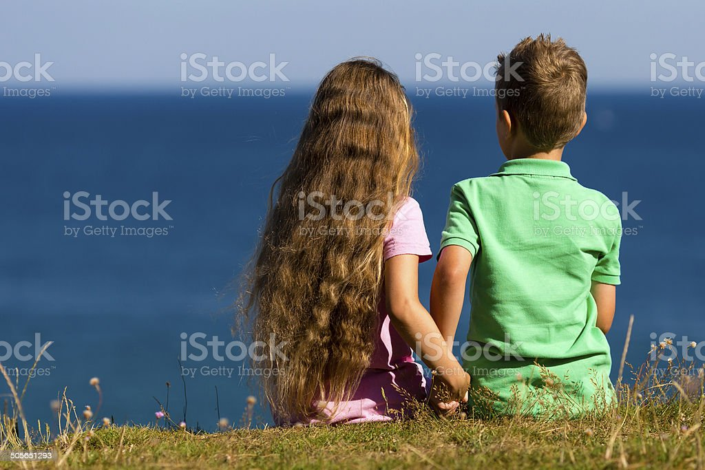 Boy and girl during summer time stock photo