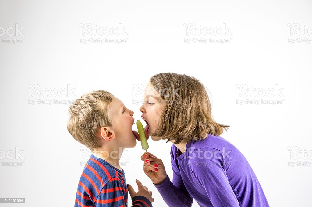 Boy and girl eating ice cream, sibling love. stock photo