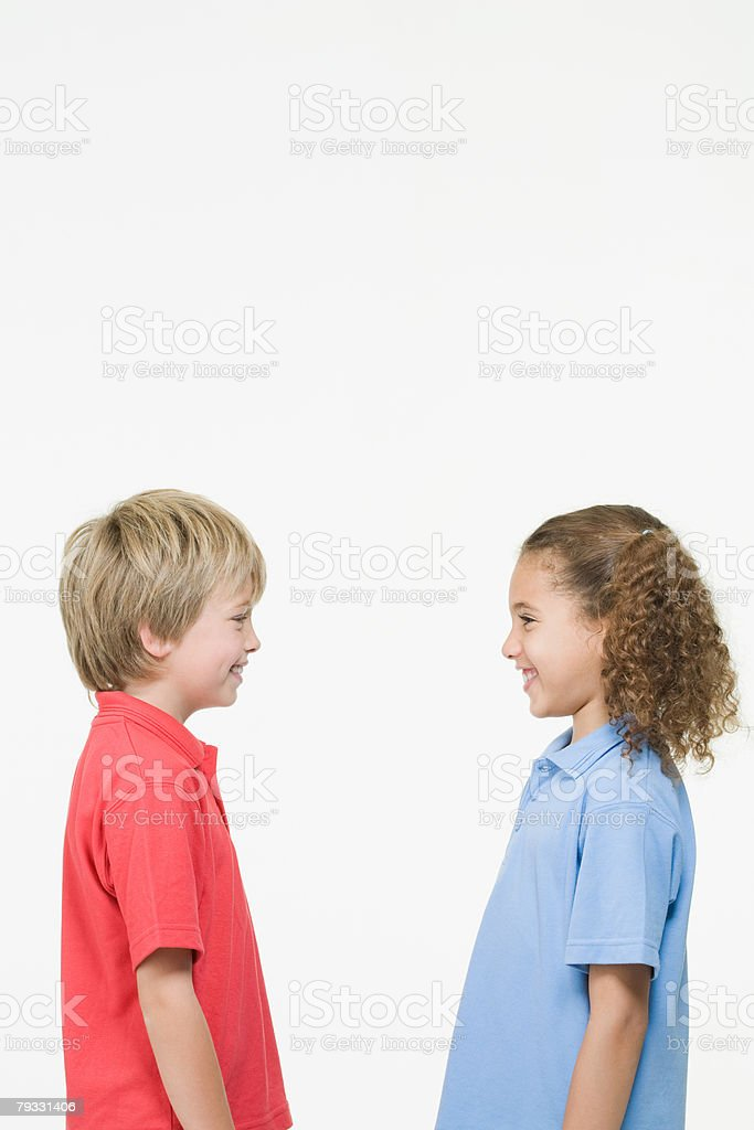 Boy and girl face to face 免版稅 stock photo