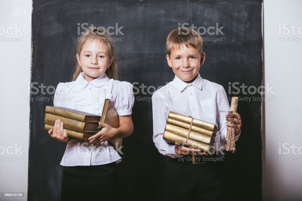 Boy and girl from elementary school in the classroom stock photo