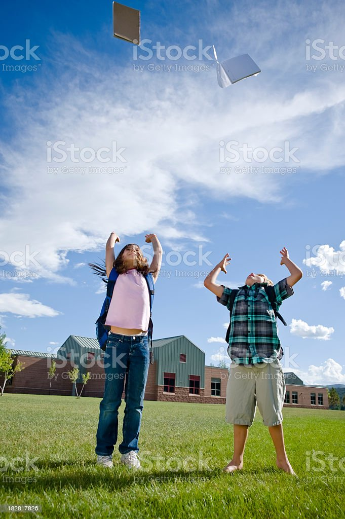 Boy and Girl happy for summer break stock photo