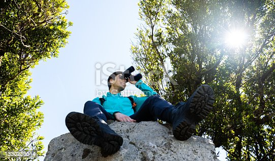 istock Boy and girl having a good day exploring mountains and forests enjoying beautiful natural landscapes 1330230514
