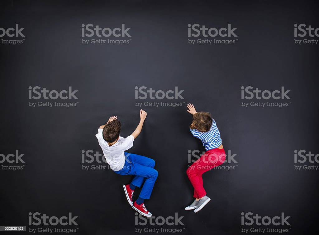Boy and girl having fun together. stock photo
