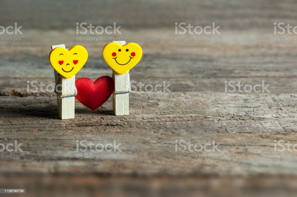 Boy And Girl Heart Yellow Emoticons With Love Stock Photo