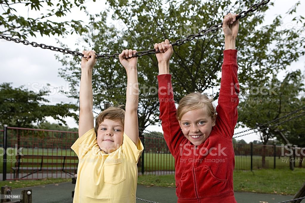Boy and girl holding a chain royalty-free stock photo