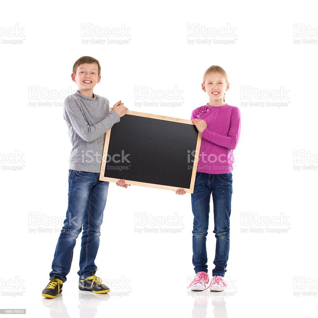 Boy and girl holding blackboard. stock photo