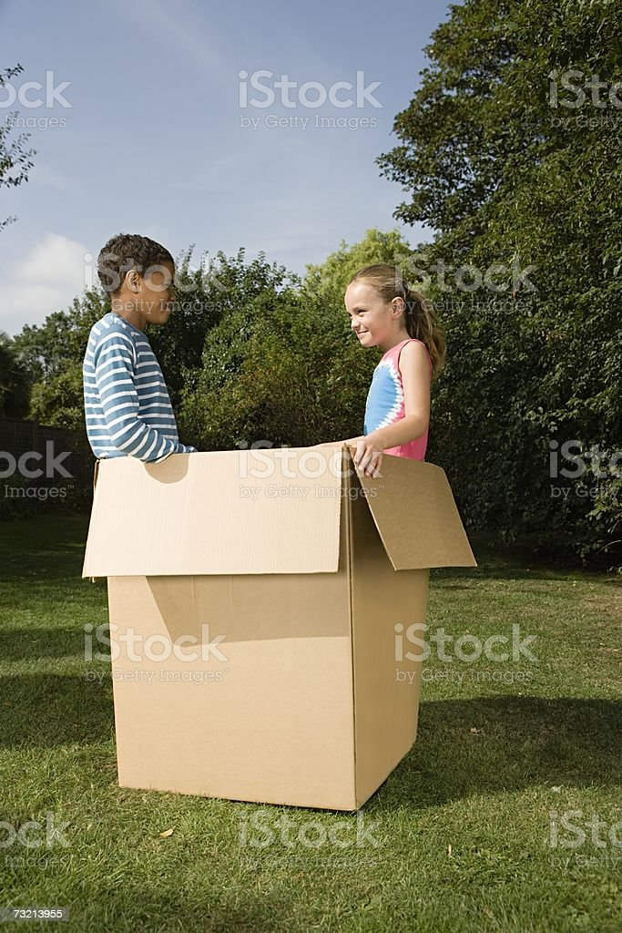 Boy and girl in a box royalty-free stock photo