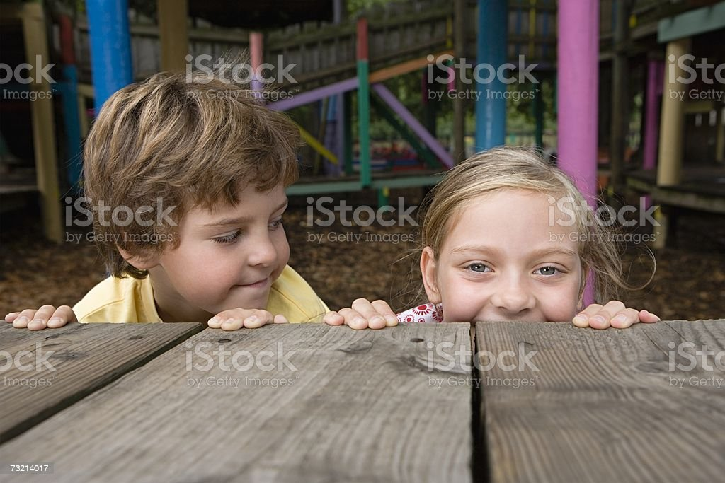 Boy and girl in a playground royalty-free stock photo