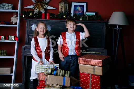 865399512 istock photo Boy and girl in new year 1068775050