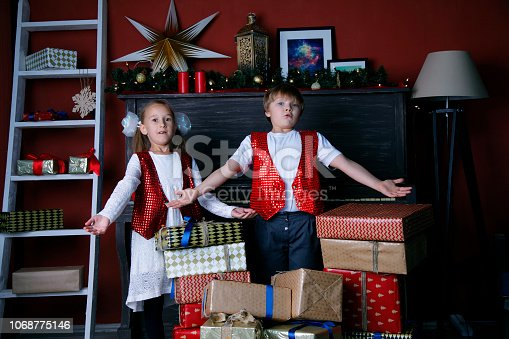 865399512 istock photo Boy and girl in new year 1068775146